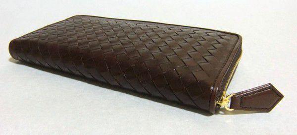 上質レザーに職人のハンドメイドによる上質な編み込みラウンドファスナー長財布です